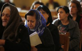 Iraqi Christians attend Mass at church in Baghdad