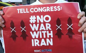 A man participates in a rally Dec. 4, 2020, in San Diego to protest after Iranian Maj. Gen. Qassem Soleimani was killed in a U.S. drone airstrike at Baghdad International Airport the previous day.