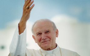 Pope John Paul II waves after arriving in Miami for his 1987 visit to United States