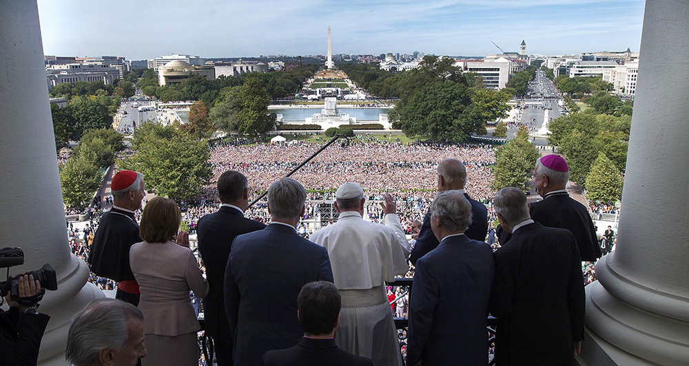 Pope Francis is welcomed to Speakers Balcony at the U.S. Capitol by members of Congress