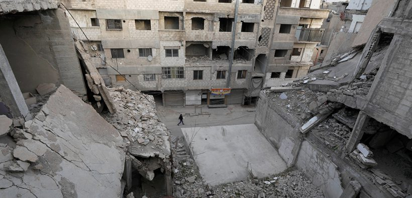 SYRIA BOY DAMAGED BUILDINGS